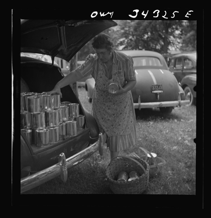 17. Women gathered at the Jefferson County Cannery, paying 3 cents a can and 2 cents for use of the pressure cooker to preserve their food in 1943.