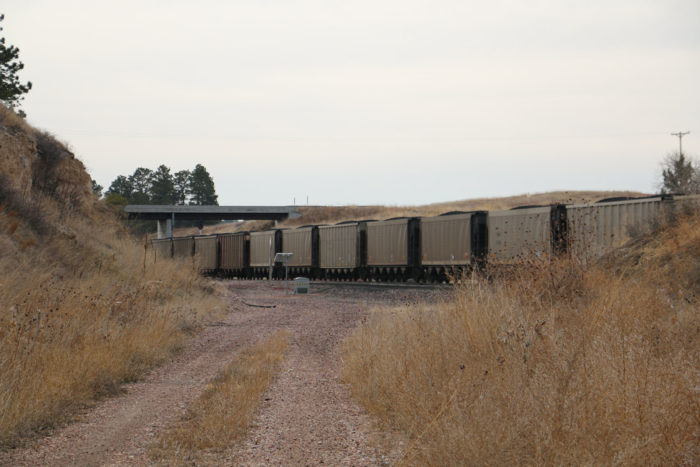 Coal cars pass by the old Belmont Tunnel track.