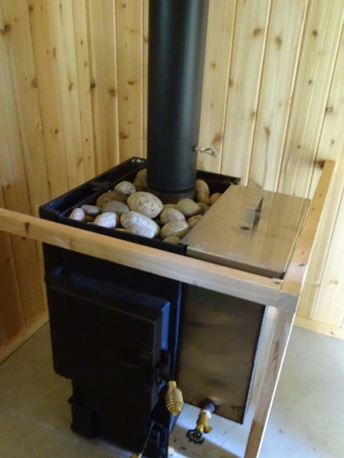 """The wood-fired Finnish sauna will provide you with the most relaxing experience you've ever had on a """"camping"""" trip."""