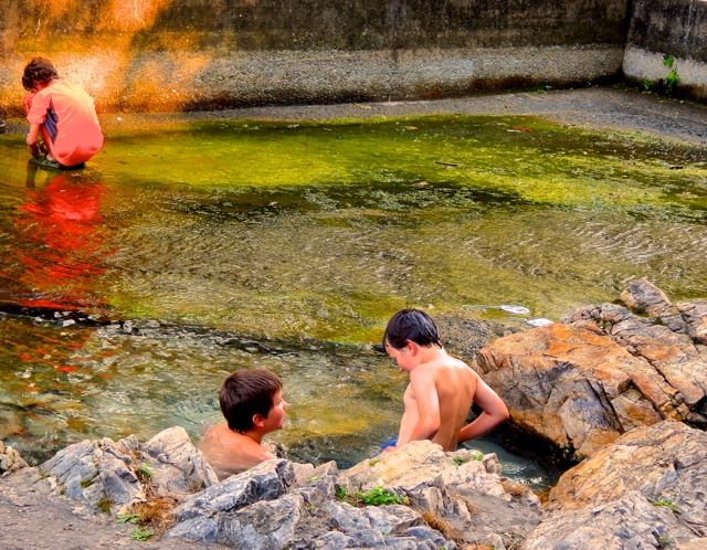 6. Children enjoying the warmth of the hot  springs.