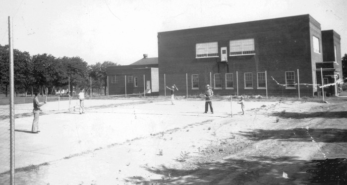 11. The students are playing tennis on the old McLoud High School tennis courts. Taken in 1940.