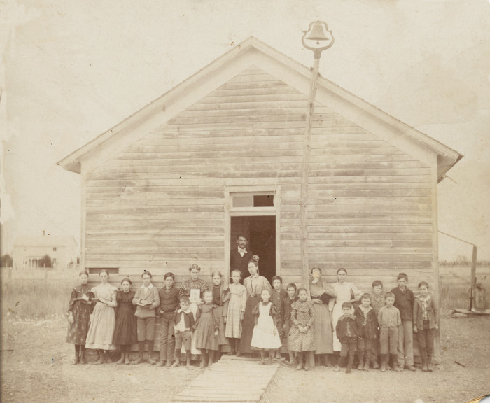 6. A class of children in front of their one-room schoolhouse in Blanchard. Taken in 1910.