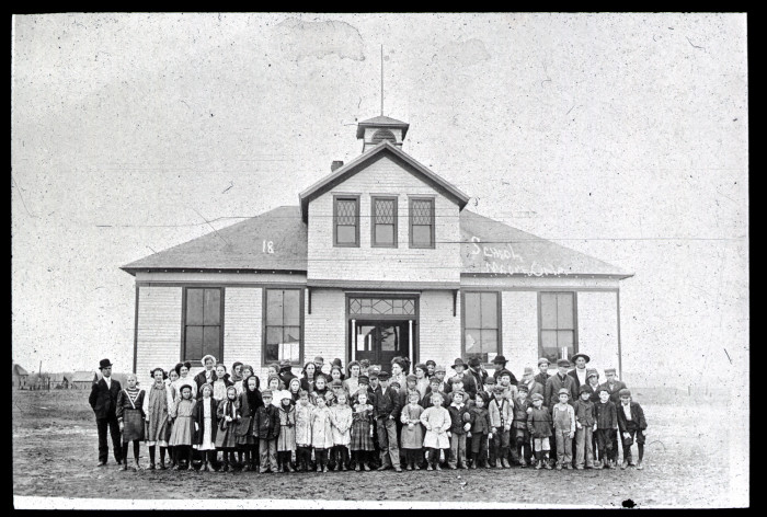 12. The students and teachers in front of a school in Moore. Date Unknown.