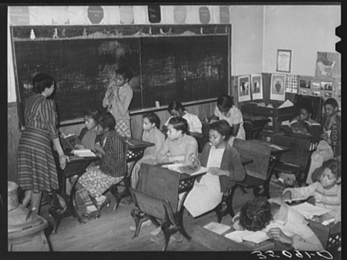 5. Many children sat two per desk in this rural school in Creek County. Taken in 1940.