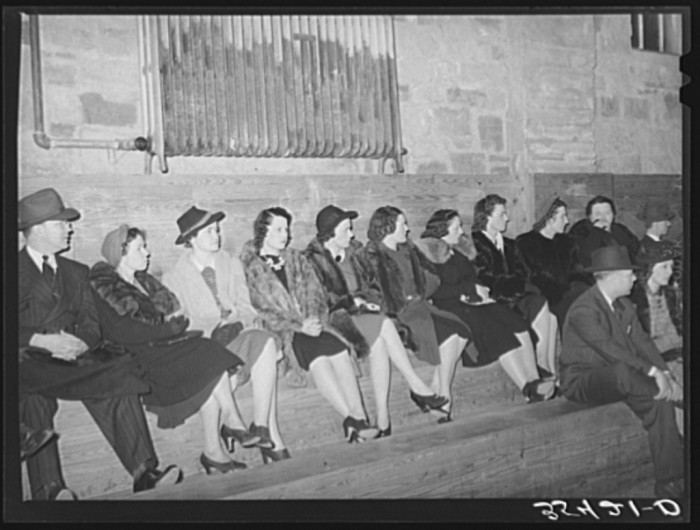9. These dressy spectators are watching the high school basketball game. Taken in 1940, Eufaula.