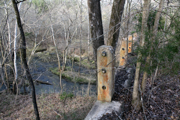 11. An old closed bridge on Hwy 378 is overgrown and has an earthen surface.