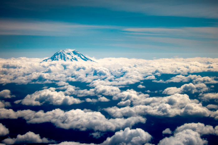 Mount Rainier above a layer of clouds.