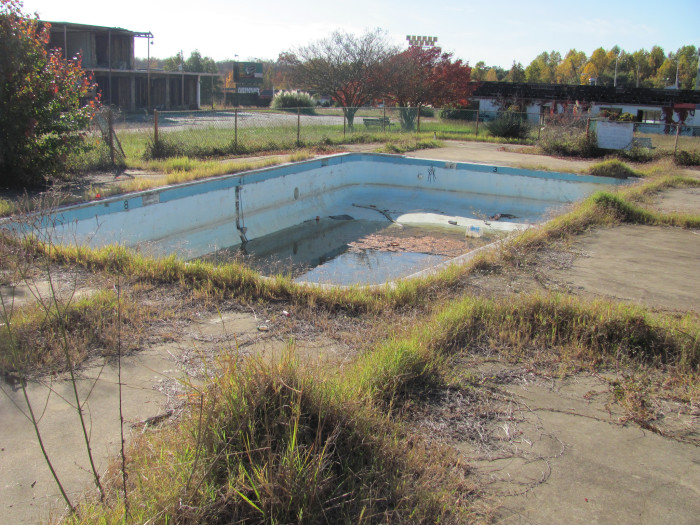 16. If you try, you can almost hear the voices of the traveling children that once played in this now-defunct pool at an abandoned motel in South Carolina.
