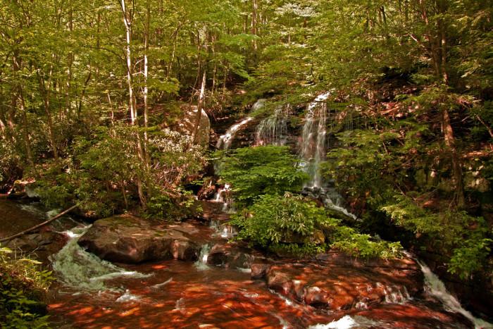 1. Waterfall with lush greenery surrounding it