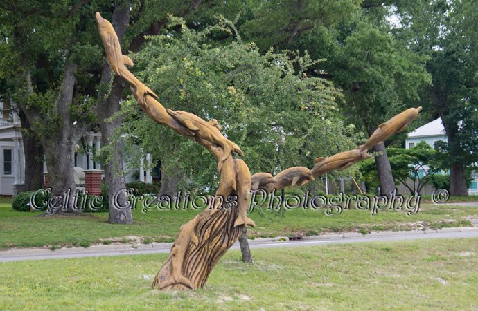 1. Dolphin Tree Carving, Biloxi