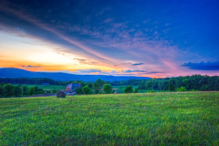 1. This beautiful image shows Sugarloaf Mountain behind rolling hills of farmland.