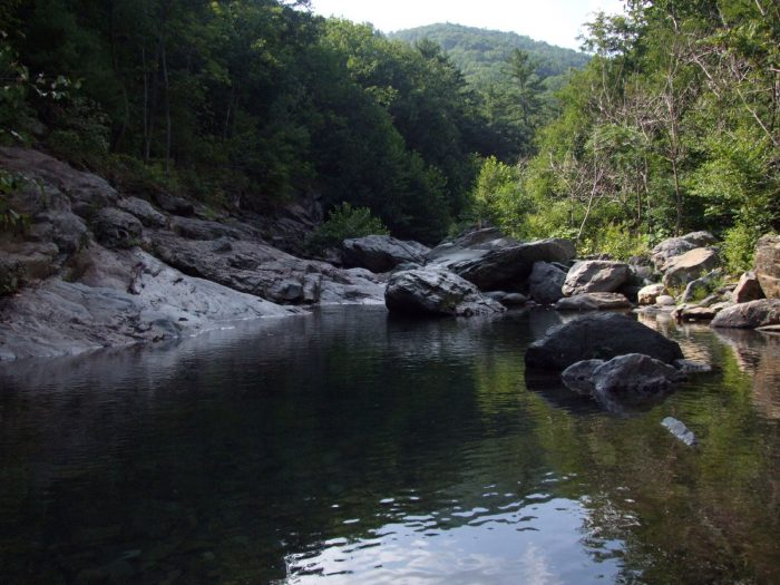 6. Taking a dip in a refreshing mountain swimming hole