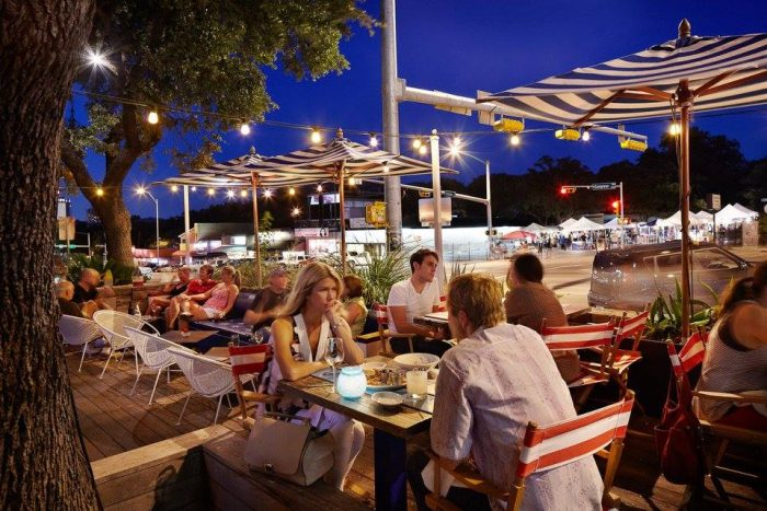 4. Fresh seafood with a view of your date and the bustling location of SoCo - Perla's Seafood and Oyster Bar.