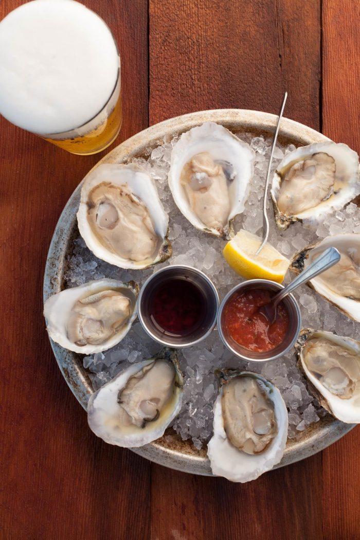 7. Enjoying a round of Rappahannock oysters...