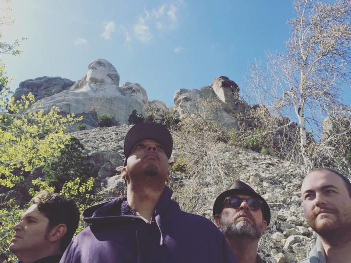 8. They take a selfie with Mount Rushmore and use a selfie-stick to do it.