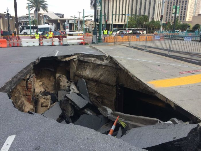 The 20 ft. wide, 20 ft. deep sinkhole is being caused by a former tunnel.