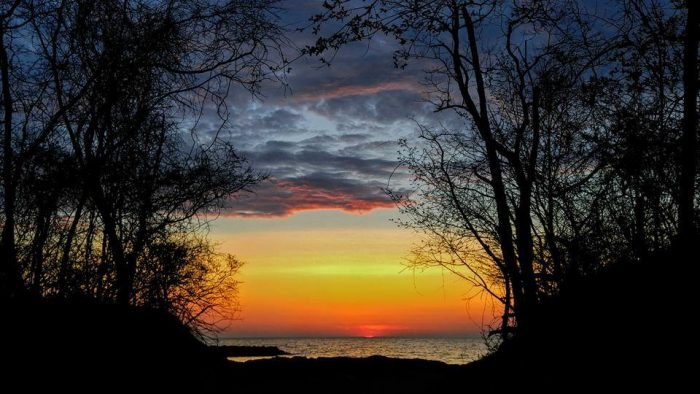 15. A dramatic sunset lights up the sky from Presque Isle State Park in this photograph taken by Sheryl Wheaton Kabasinski.