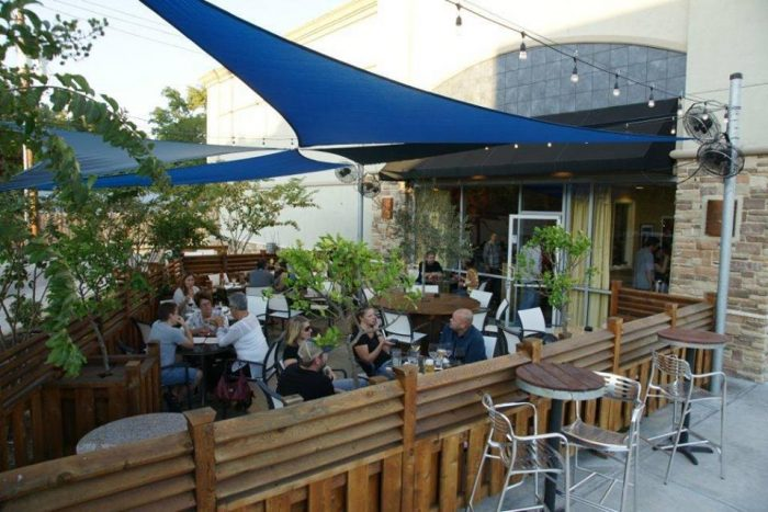 14. Enjoy happy hour on a rooftop or patio.