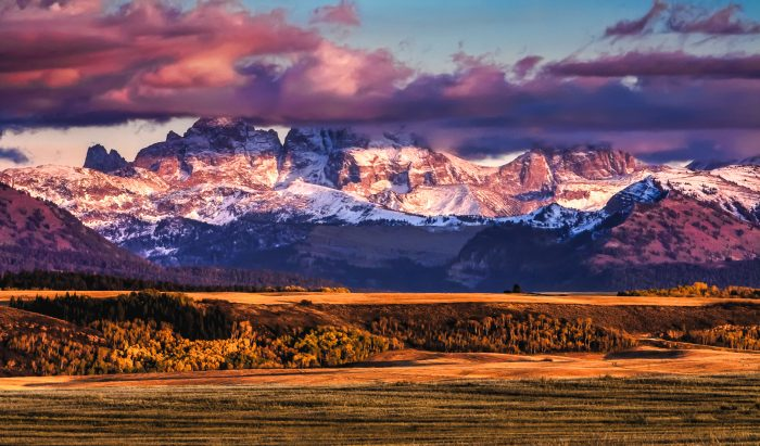 1. The Idaho Tetons simply bask in the glow of the setting sun in this photo.