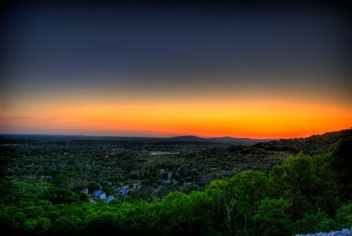 11. A colorful sunset is overlooking the city of Huntsville.