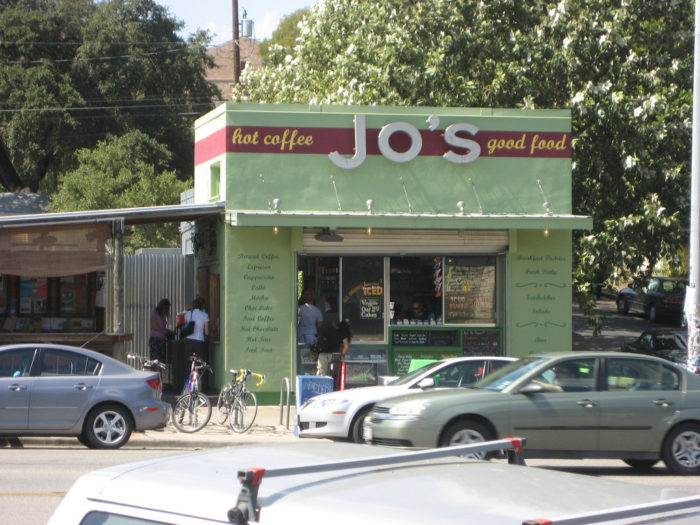 """6. Jo's Coffee flagship on South Congress is the place to get your hot coffee and other snacks. Don't forget to snap your souvenir photo on their """"I love you so much"""" wall!"""