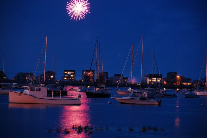 11. This beautiful shot makes this firework burst look like a brilliant red moon, its light reflected as a surreal pink glow over Scituate harbor.