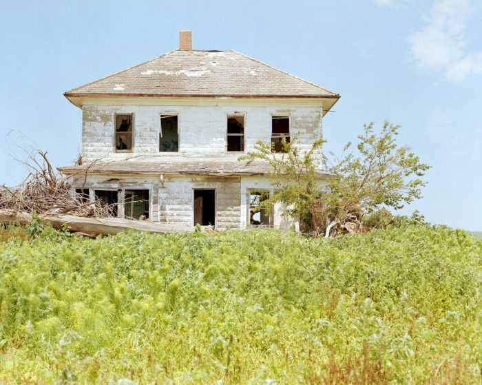 5. An abandoned rural home still stands proud on a hill, as though its ghosts are guardians of the surrounding fields.