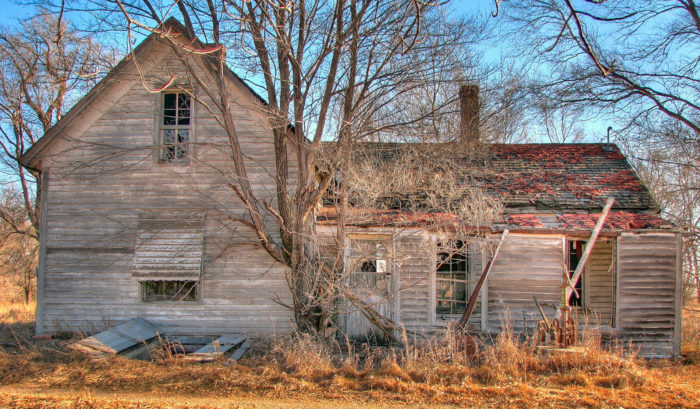 3. This beautiful abandoned home once held the sounds of a family. Now it stands alone, empty, and forgotten.