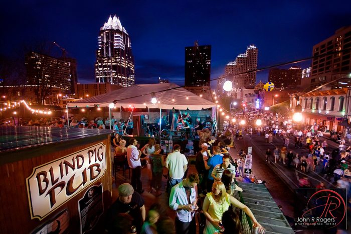 9. Watch 6th Street chaos from above at Blind Pig Pub's sweet rooftop patio.
