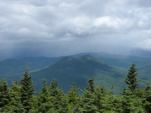 7. These twin peaks are hidden among larger mountains in the New Hampshire woods.