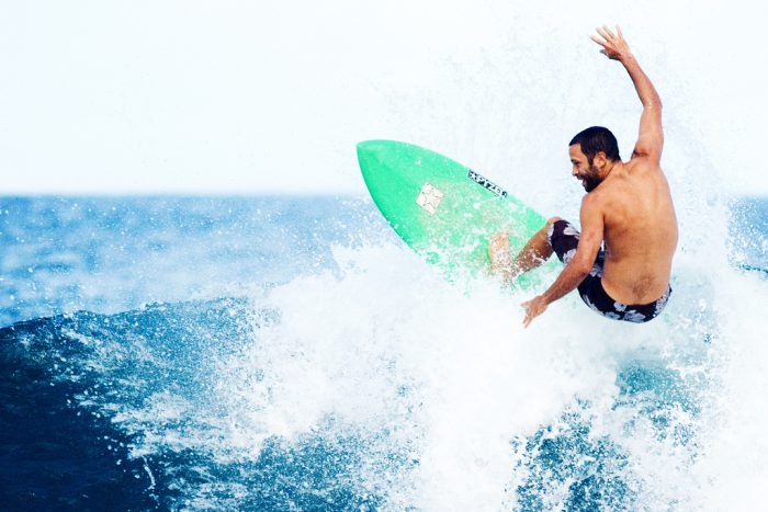 4. Watch the waves and admire the surfers.