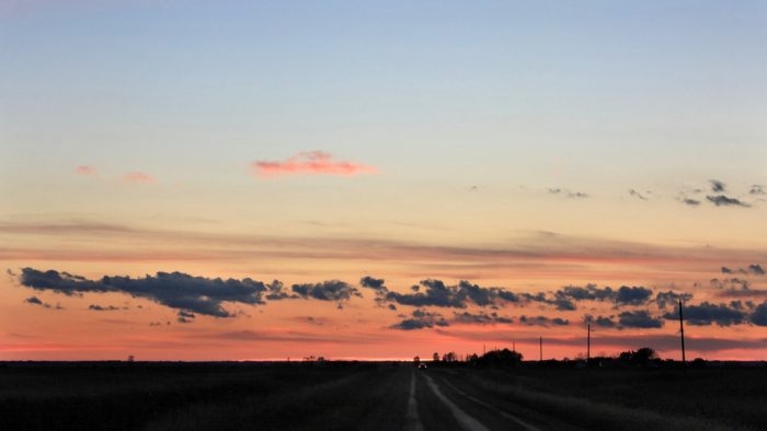 1. Take a drive down some country roads at sunset, then stop the car and take in the night sky.