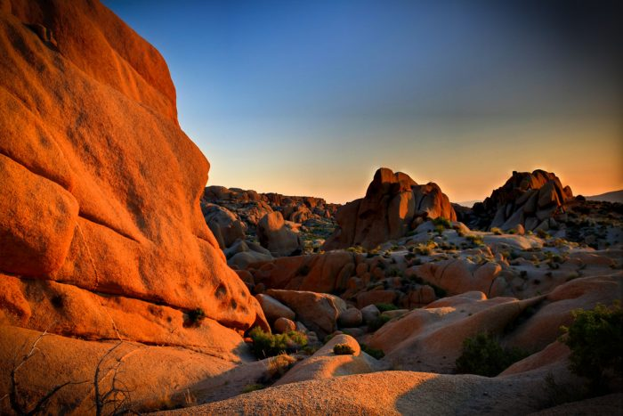 10. Southern California solitude in Joshua Tree. Rugged desert rocks bathed in a warm glow at sunset.