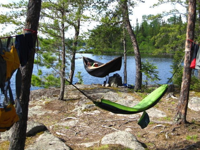 8. Hang a hammock by the water. Nothing is more relaxing than letting the hours slip away while you relax between the trees.