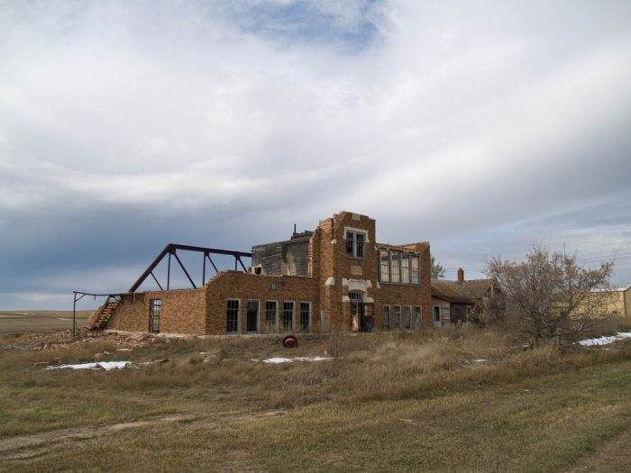 This was once the school, now partially collapsed and deteriorating.