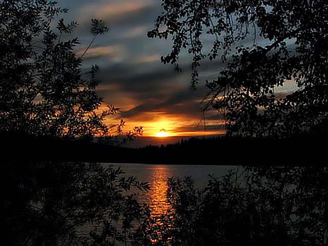 14. Hauser Lake in Northern Idaho is captured beautifully with this sunset reflection ont he water.
