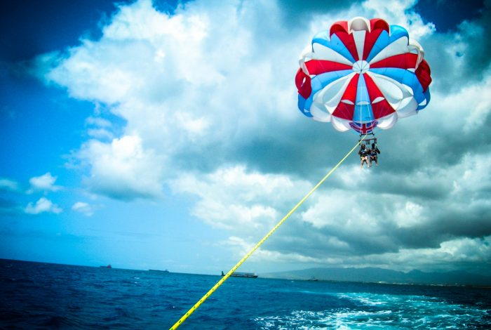 7. Soar above the water and try parasailing.