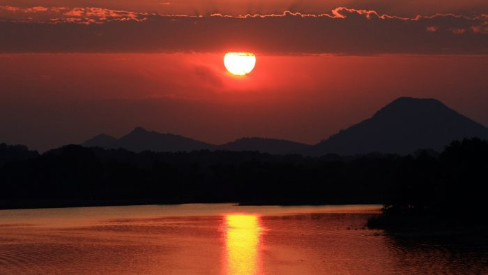 13. View a sunset from across a river.