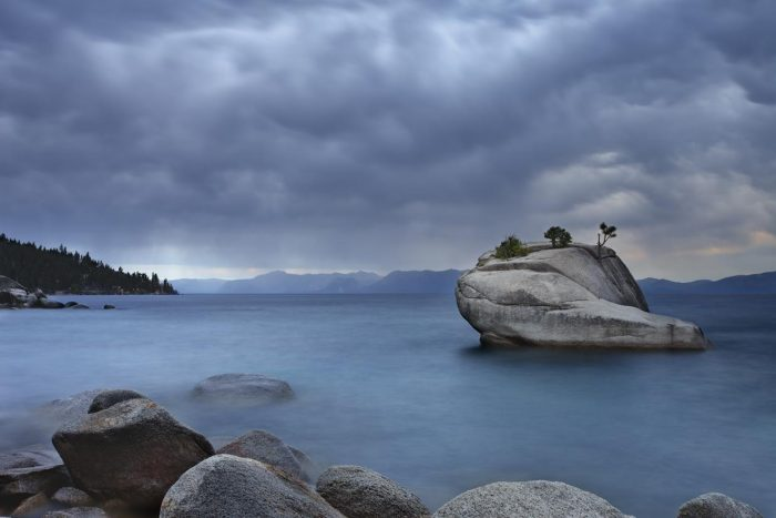 2. A storm is overlooking Lake Tahoe and moving towards Bonsai Rock.