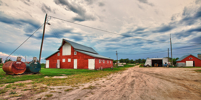 1. This farm with beautiful red barns and the wide open sky stretching above it.