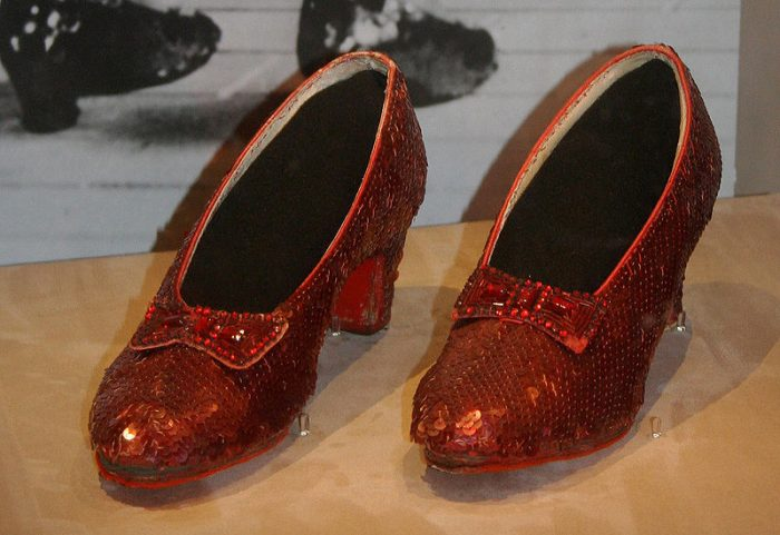The  ruby slippers in question were one of the pairs designed by Gilbert Adrian for Judy Garland in The Wizard of Oz.