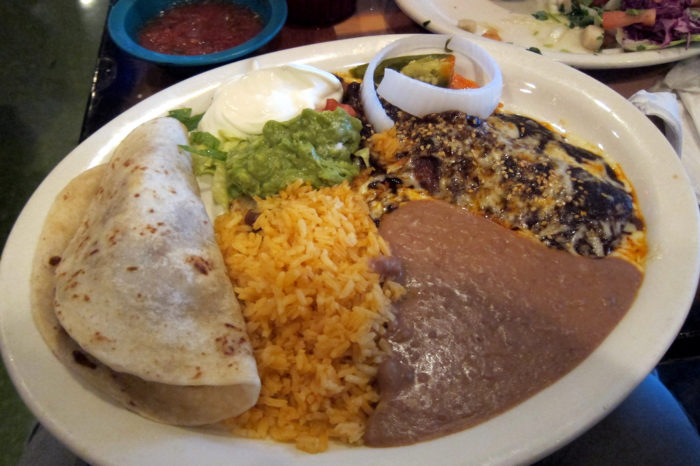 8. Get the best of both worlds - One taco and one enchilada all in one dinner plate, from Polvos Mexican Restaurant!
