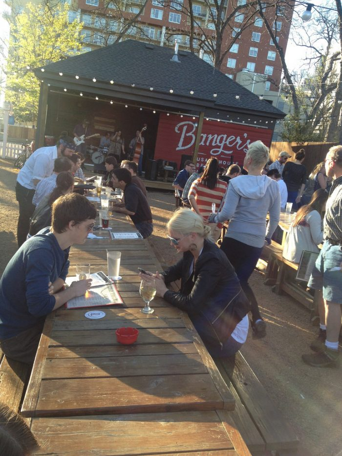 """2. Banger's has the ultimate functioning and entertaining patio - Communal seating, gated dog """"park"""", and live music stage."""