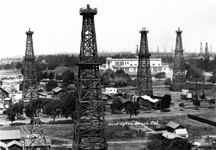8. Central Grammar School in Huntington Beach in the 1920s surrounded by oil derricks.