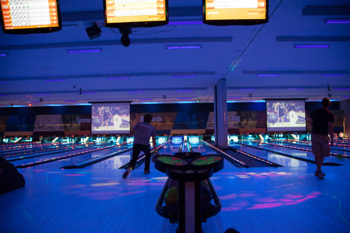 2. Lights down low, big screens on, and a little competition bowling with your boo at Main Event.