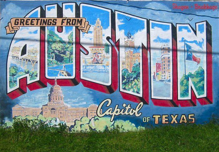 8. Take a photo at one of the city's mural walls (or tagged graffiti walls).