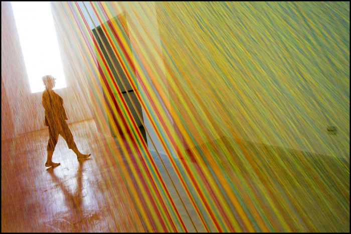 5. A tour guide walking past the Zadok Gallery in the Wynwood Art District of Miami.