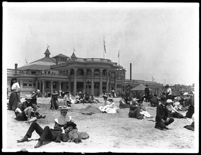 2. Sunbathing at Long Beach in front of the Bath House wearing suits, dresses and hats!