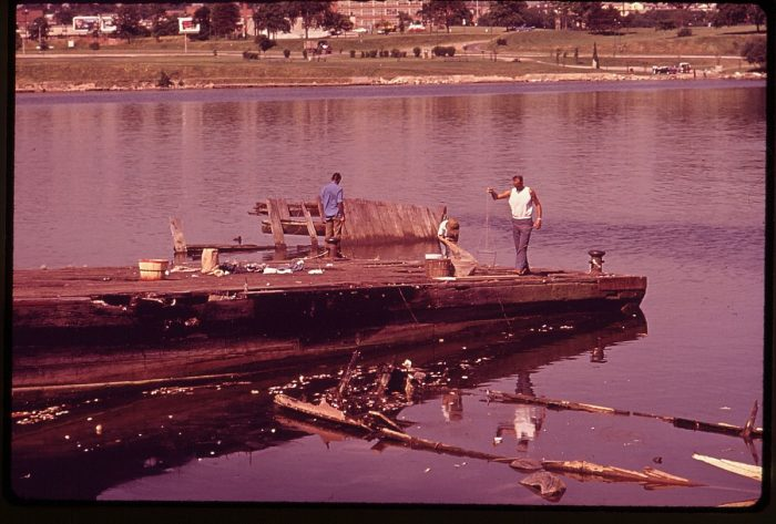 3. Also in 1973, these men can be seen crabbing off a deteriorating dock near Port Covington in the Baltimore Harbor.