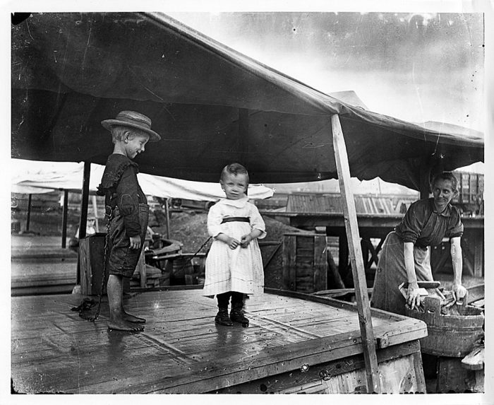 7. Children on a boat at the C & O Canal, in one of the Cumberland basins. Photo circa 1910.